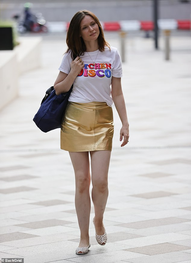 Outfit: The hitmaker cut a stylish figure for the day, donning a white T-shirt with a multi-coloured 'Kitchen Disco' print