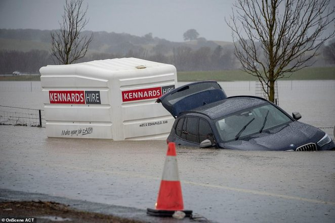 Canberra suffered extreme and torrential rain on Sunday. Pictured: A car caught in the floodwaters