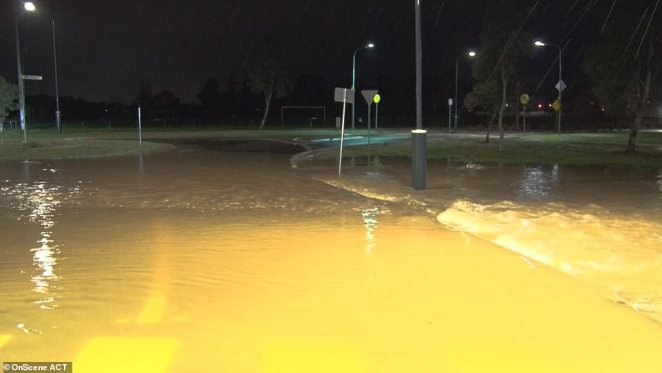 Roads were inundated with water both in NSW and ACT (pictured). SES warned residents who chose to remain in their properties that they may get stuck