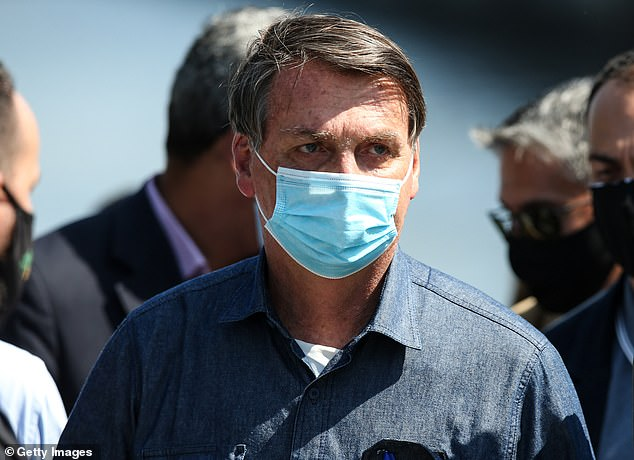 President Jair Bolsonaro (above) has faced severe criticism for downplaying the virus and attacking social distancing measures adopted by state and local authorities