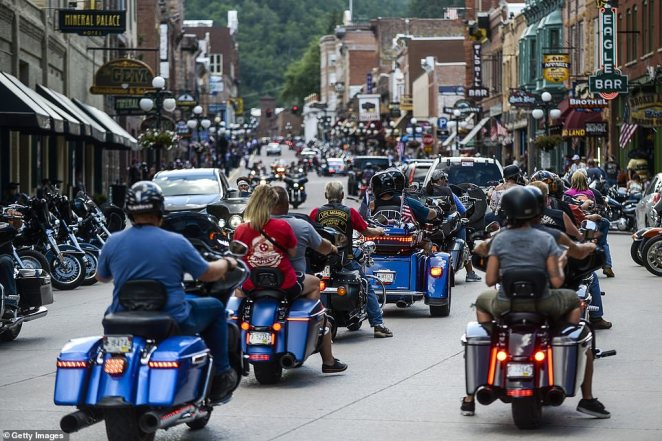 A train of cyclists pictured riding through downtown Deadwood, South Dakota.Officials say a number of bikers have already tried to enter tribal land but were turned away