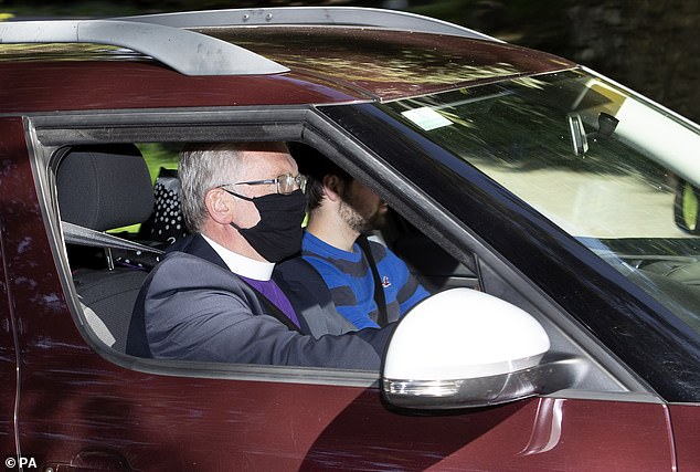 Reverend Kenneth MacKenzie wearing a protective mask arrives at Crathie Kirk ahead of the Sunday service which Queen Elizabeth II usually attends during her summer vacation at Balmoral