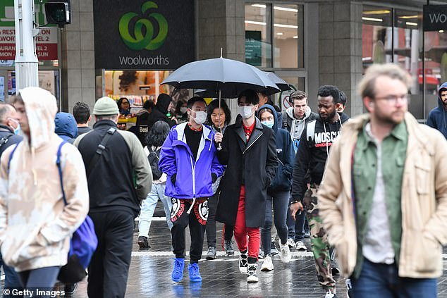 Dr Coatsworth said until a vaccine was developed Australia only has 'two blunt tools' to tackle the virus, extreme social distancing and stage four restrictions (people pictured in Sydney's CBD)