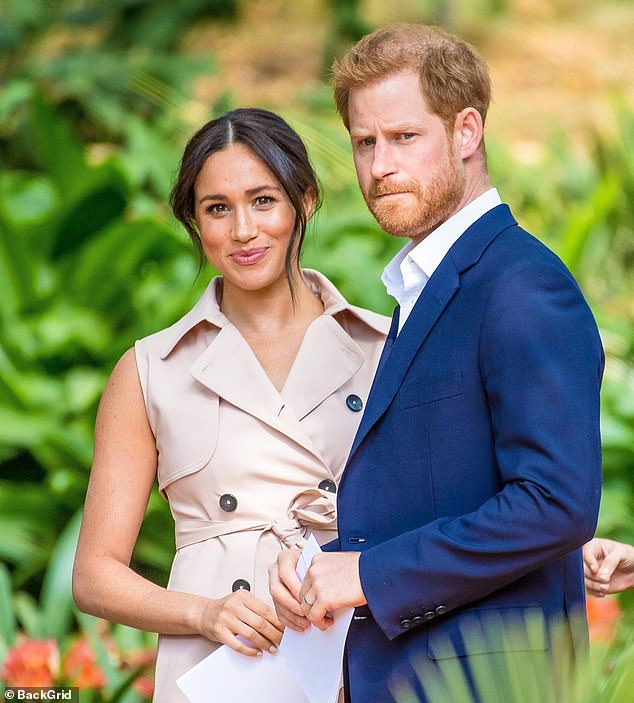 The Duchess of Sussex has helped guide Prince Harry on his `` waking journey '', the authors of the couple's upcoming biography have claimed.
