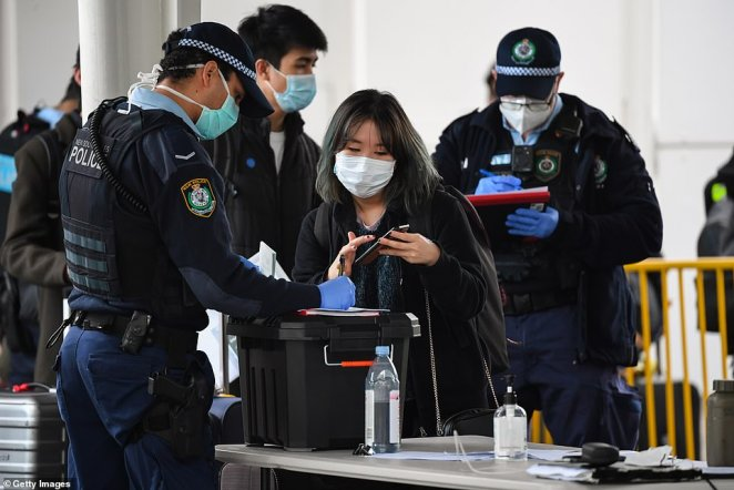 Of the new cases, only one was a returned traveller in hotel quarantine. Pictured: A passenger from Melbourne arrives in Sydney on Saturday
