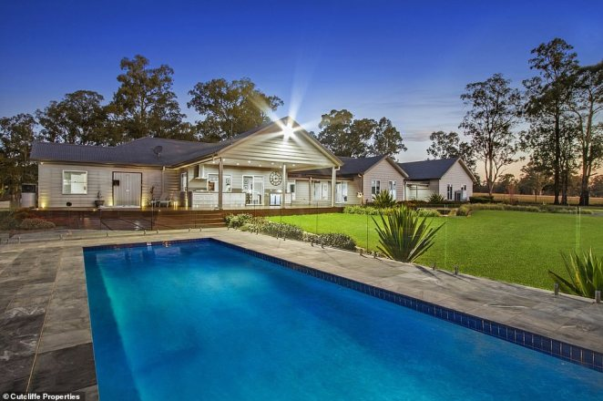 An expansive Western Sydney estate (pictured) has been put on the market and features an incredible alfresco outdoor area with swimming pool and spa