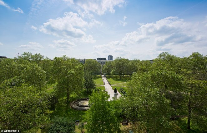 Thetrophy property would serve as an excellent long-term investment and main London residence, with views of the park from the back of the property (Pictured: the view from 15 Grsovenor Square)