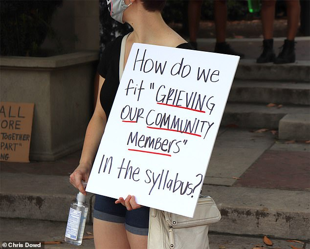 "One sign read: 'How do we fit ""grieving our community members"" into the syllabus?'"