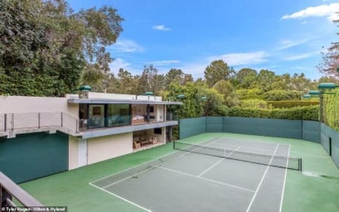 Spacious: The home has four bedrooms and 12 bathrooms, plus a two-story guesthouse by the newly added tennis court for a total of five bedrooms