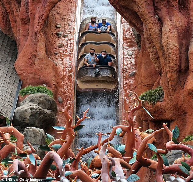 Guests wear face masks on the Splash Mountain ride. Several rides have been adapted with partitions and barriers between vehicles to enable guests to enjoy the popular attractions safely and with minimal contact with others
