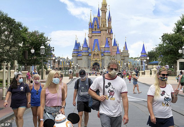 Disney World will shorten its opening hours from September as the so-called 'Most Magical Place on Earth' tightens its COVID-19 safety measures. Pictured guests at the Magic Kingdom on July 11