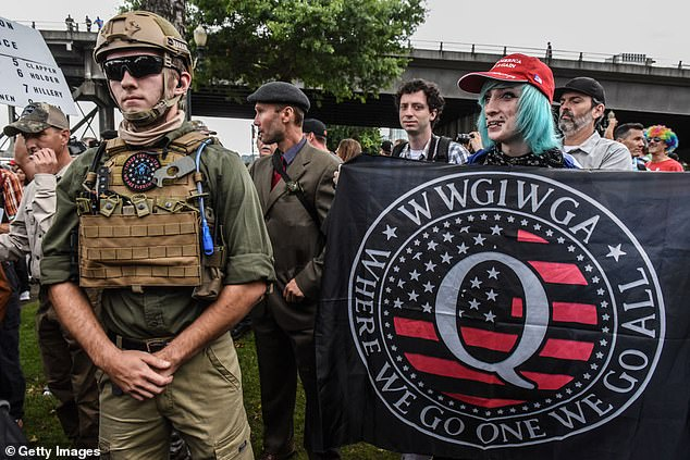 QAnon supporters rally in Portland, Oregon, in August 2019, showing their support for Trump