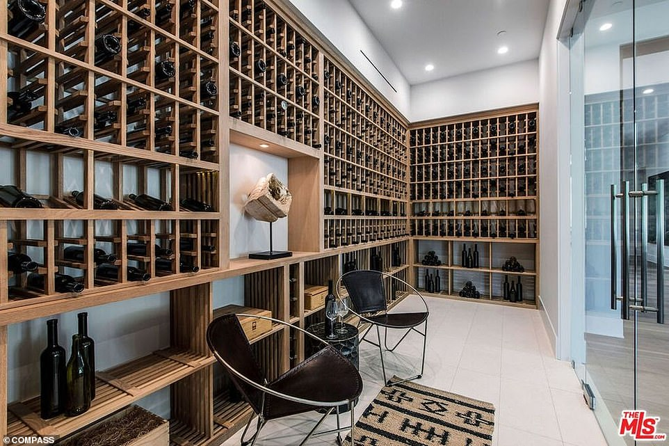 They'll certainly be needing a drink: The couple can treat themselves to a glass of vino in this stylish wine cellar