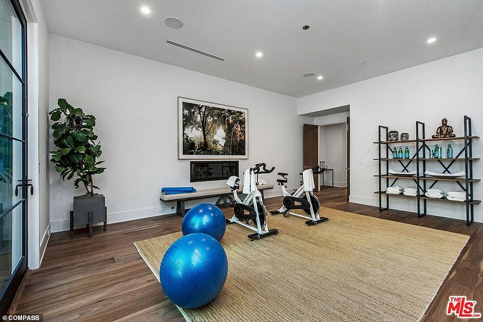 Keeping fit: The home also features a gym, as well as another communal gym on site