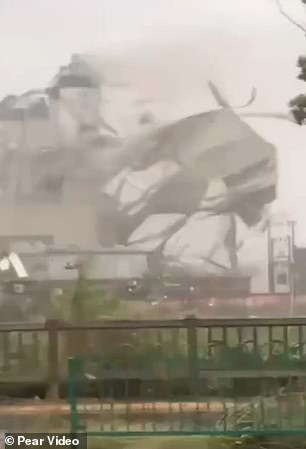 Footage captures the terrifying moment part of the structure being ripped through and blown away by the strong gales