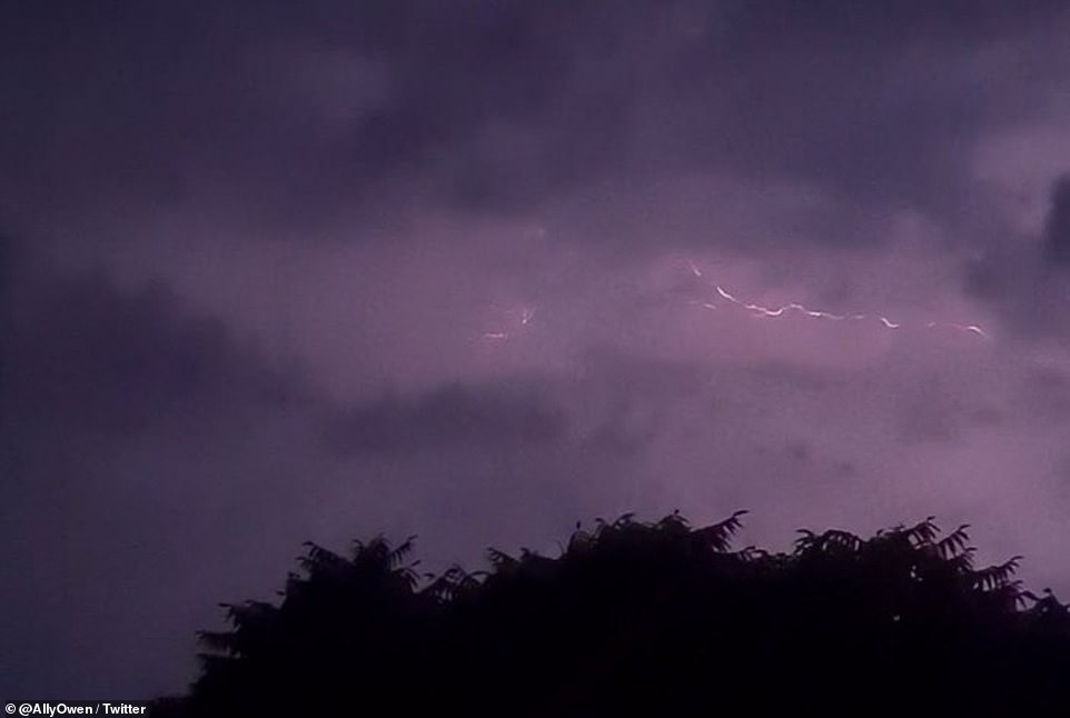 Dramatic thunderstorms strike overnight at Wrexham in North Wales as Britons experienced a 'tropical night' with 68F heat