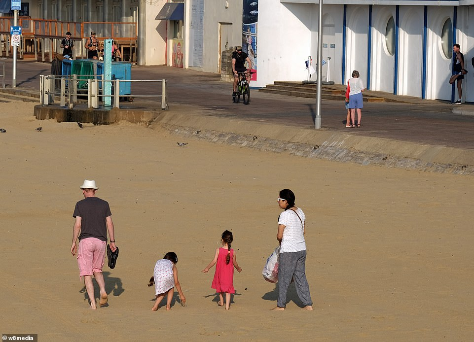 Families flock to Bournemouth beach this morning to take advantage of sunshine in the south as the heatwave continues