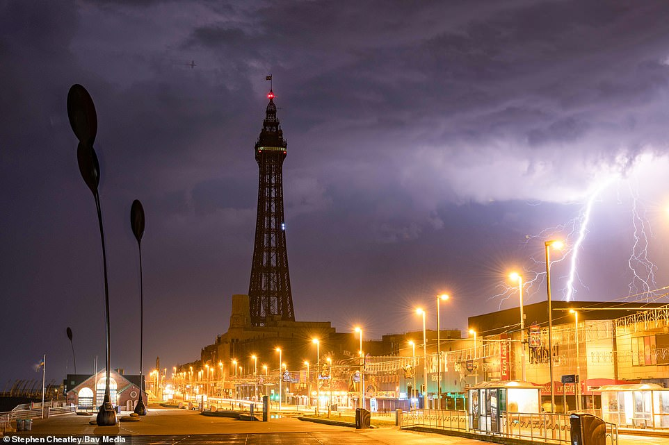 Lightning strikes near Blackpool Tower in Lancashire in the early hours of this morning as thunderstorms arrive in England