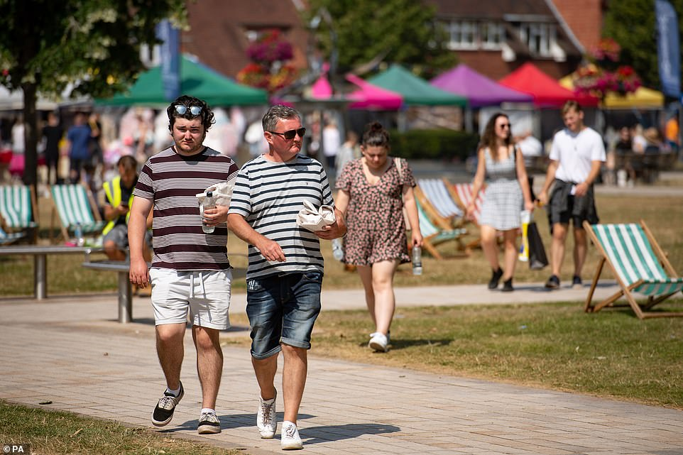 People enjoy the hot weather at Stratford-upon-Avon in Warwickshire this afternoon as the heatwave continues