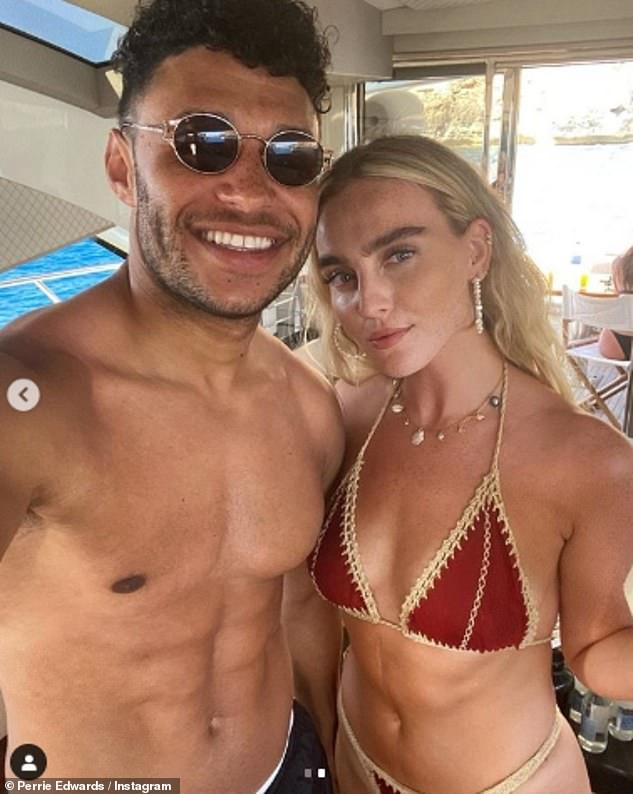 Smitten: Perrie and her Alex looked loved up for their snaps on the yacht