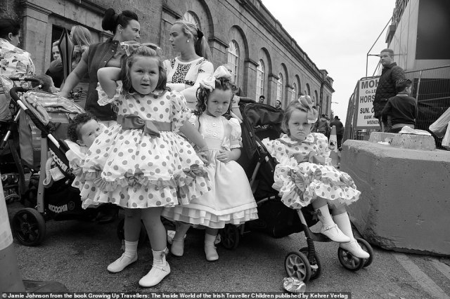 Four traveller toddlers look suspiciously at the camera as their mothers chat in the background in this photograph by US photographer Jamie Johnson, who spent five years following the community in Ireland