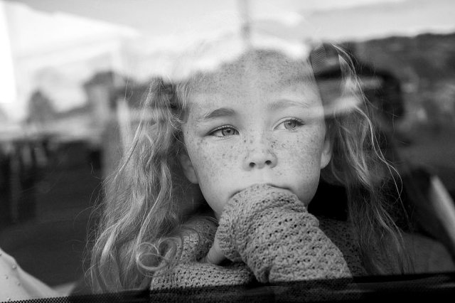 A young Irish traveller girl stares out of the window in this picture taken by US-based photographer Jamie Johnson, who spent five years gaining the trust of a group of traveller communities in Ireland