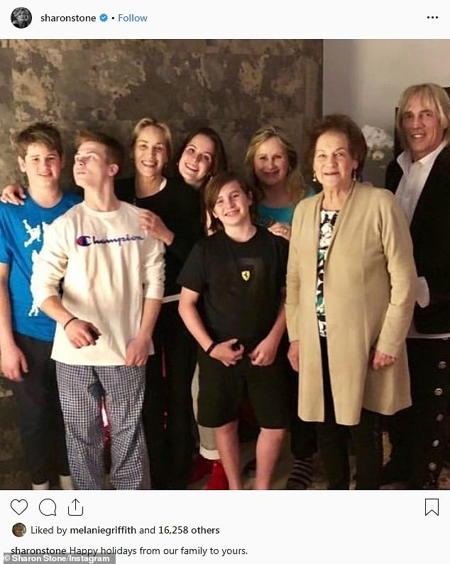 With her family: The icon with her three sons as well as her sister Kelly, brother Michael and mother Dorothy