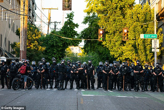 Police in Seattle block the road to protesters during a demonstration on July 26