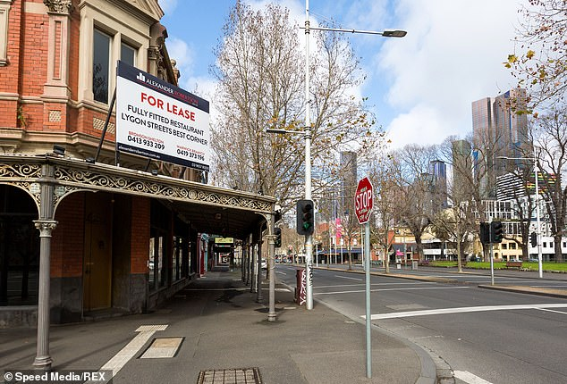 The economic effects of COVID-19 were blamed for the an increase in funds set aside for bad loans. Pictured is a deserted Lygon Street in Melbourne, once the home of thriving Italian restaurants