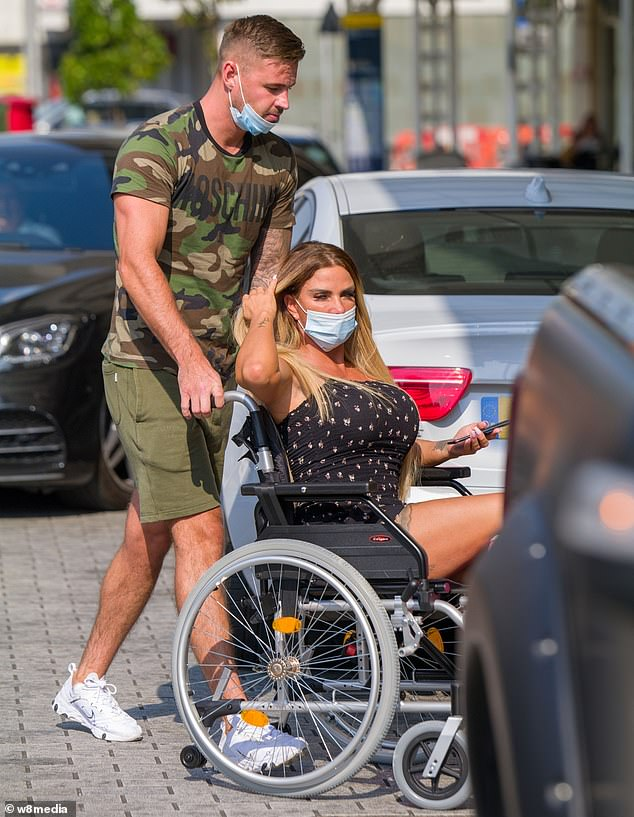 Heatwave: The mother-of-five dressed for the sunny climes in a tiny black ditzy print dress and wore a face mask as she headed into the hospital