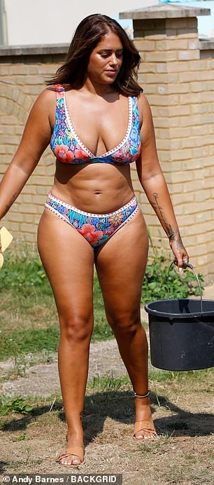 Working it: Malin Andersson proudly showed off her curves as she stripped down to her bikini in the heatwave to wash a car ahead of a charity raffle on Monday