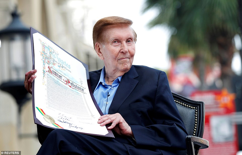 Sumner Redstone holds a proclamation to his name before unveiling his star on the Walk of Fame in Hollywood, California