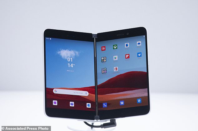 Microsoft Surface Duo is displayed in New York. Microsoft is back to selling smartphones for the first time since it abandoned its mobile business more than four years ago