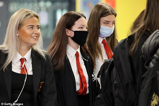 Students have been told they will be allowed toto sit exams in the autumn if they are unhappy with their mock grades or the results awarded by exam boards. Pictured:Pupils return to St Paul's High School for the first time since the start of the coronavirus lockdown nearly five months ago on August 12, 2020 in Glasgow