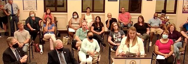 Jennifer Whitlock urged officials not to mandate mask-wearing at schools in the midst of the coronavirus pandemic. She is pictured speaking at a Paulding County School District Board of Education meeting on Wednesday night