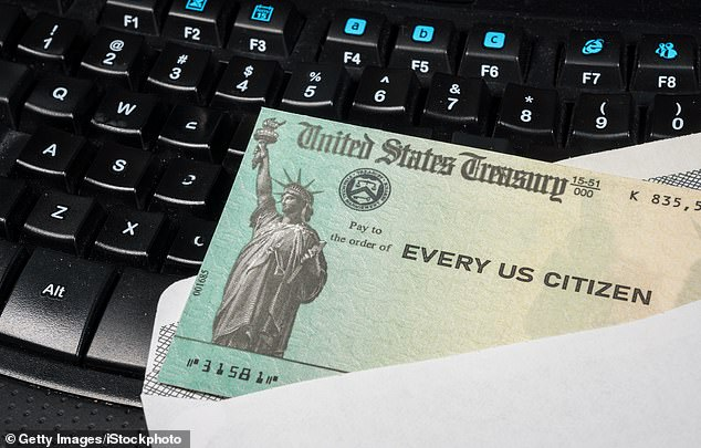 An insider with the Internal Revenue Service (IRS) believes that Americans may not get their second stimulus check (file image) until September if Congress is unable to reach a deal by Friday