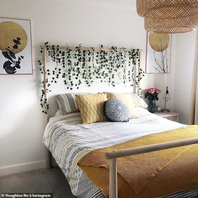 Thousands of homeowners are obsessing over a stylish bed from IKEA that allows you to hang plants and fairy lights from its wooden frame (pictured)