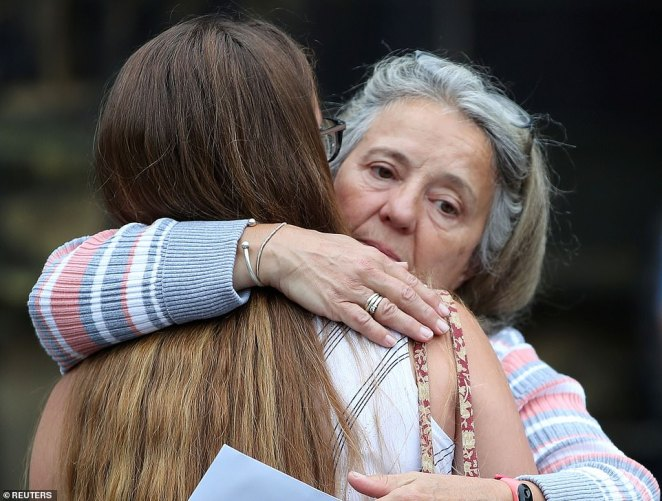 A sixth form student is embraced after receiving her A-Level results at The Crossley Heath Grammar School in Halfax today