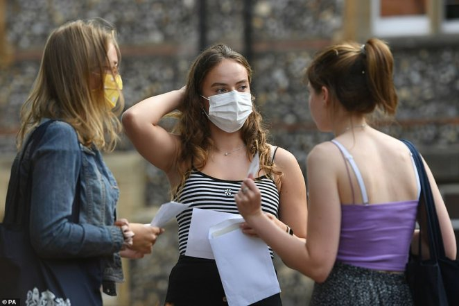 Benita Stipp (centre) and Mimi Ferguson (left) react as students at Norwich School receive their A-Level results today