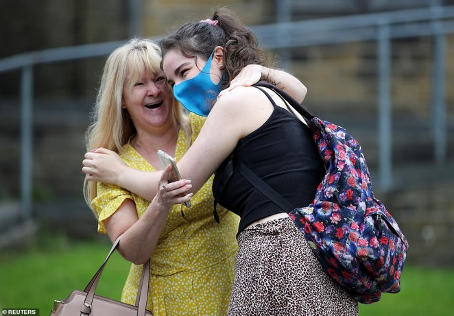 A sixth form student reacts after receiving her A-Level results at The Crossley Heath Grammar School in Halifax today
