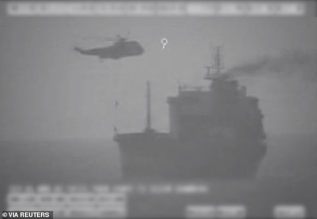 A black-and-white screenshot from video released by the U.S. military, allegedly shows Iranian forces members fast-roping onto the civilian tanker