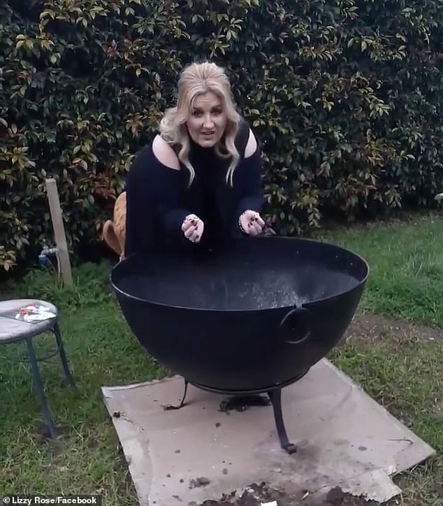 Ms Rose, who wore a black dress during the performance, was seen bent over a large black cauldron with a lit match held over a needle