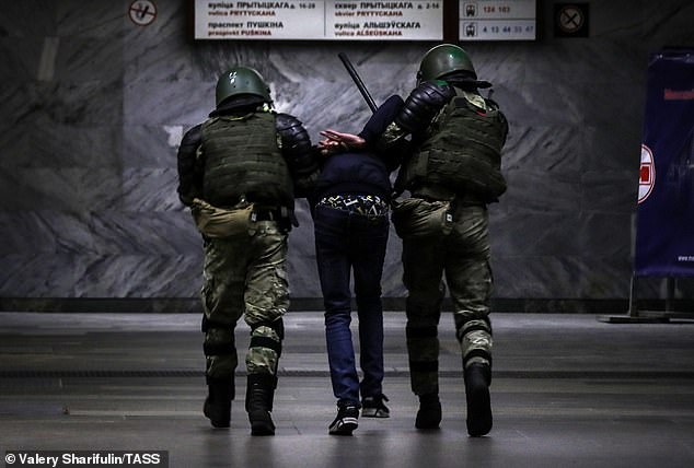 Belarusian law enforcement officers escort a participant in a protest against the results of the 2020 Belarusian presidential election. Mass protests erupted in major cities across Belarus in the evening of August 9