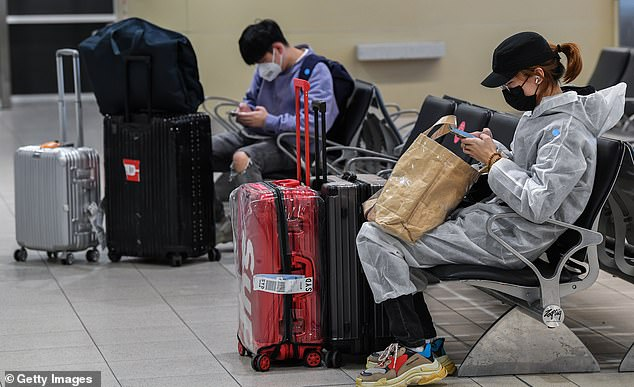 Passengers in the baggage hall at Sydney Airport after arriving on a flight from Melbourne on August 5