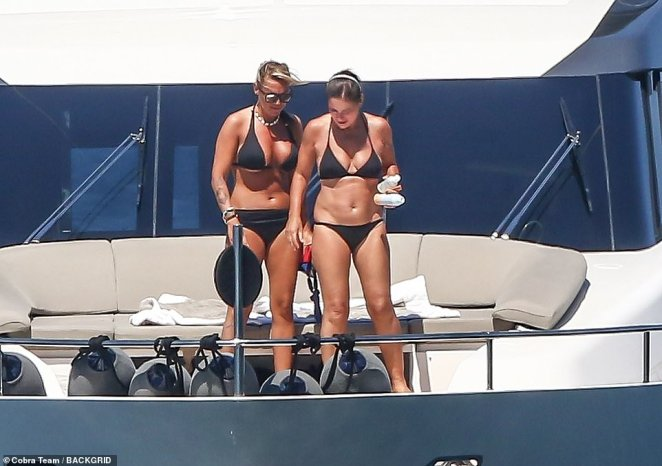 Silvio Berlusconi's ex Francesca Pascale, left, and her romantic love interest Paolo Turci, right, pictured on their sun soaked holiday on their luxury yacht out in Costiera Sorrentina in Italy