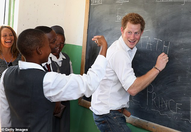 Prince Harry has spent a lot of time in Africa for his charity work. He is pictured in Lesotho in 2013 learning sign language at a school supported by his Charity Senteable