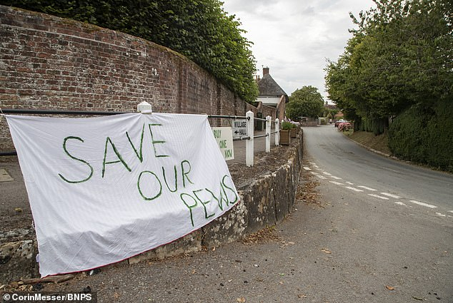 Some have been bought by the parishioners wanting to stop the pews from leaving the picturesque village - including the village shop and the village pub, the Royal Oak