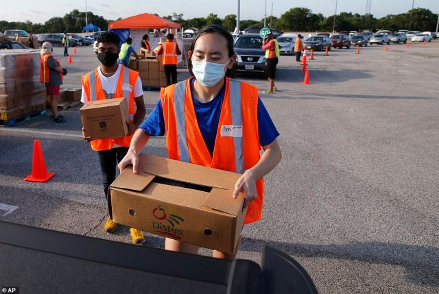 Images show vehicles weaving through parking lots as over 90 volunteers got to work distributing 10,000 boxes