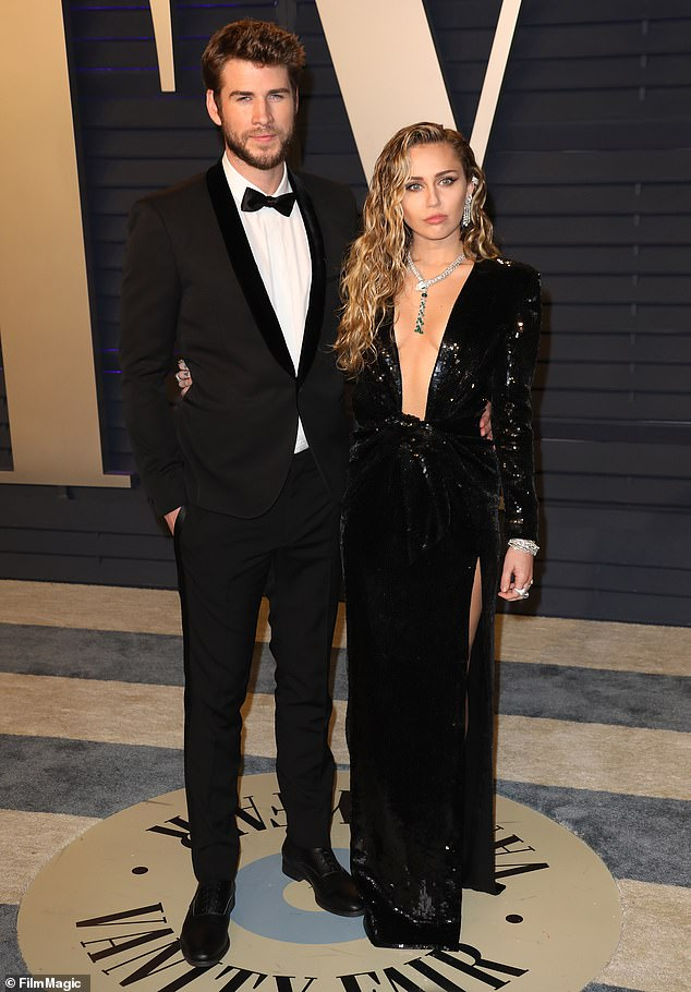 Case of the ex: Liam and Miley are pictured in February 2019, before their shock breakup