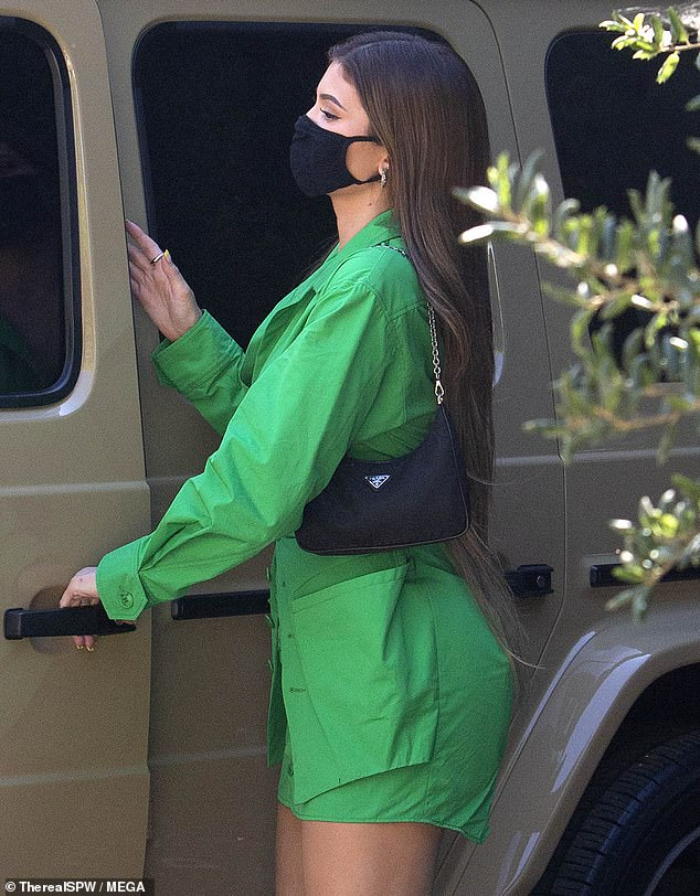 Leggy display: As she sauntered into the eatery, Jenner could be seen wearing a thigh-skimming green dress with her caramel-colored tresses cascading down her back
